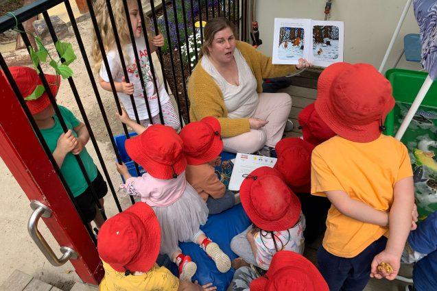 Rebecca reading to kids